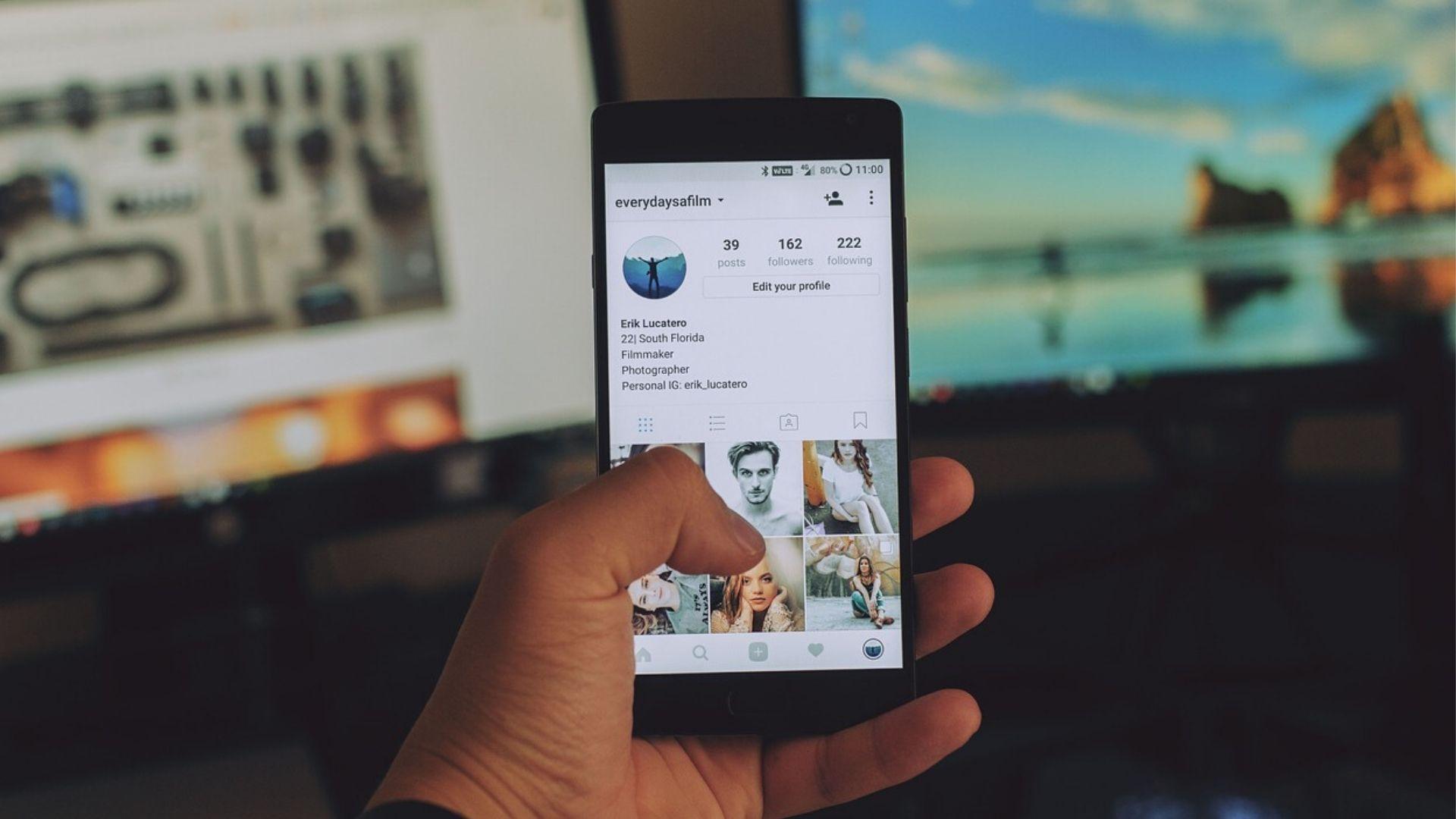 blog image - social media - guy scrolling through instagram